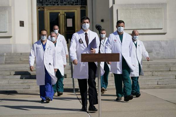 Associated Press Dr. Sean Conley, center, physician to President Donald Trump, and other doctors walk out to talk with reporters at Walter Reed National Military Medical Center on Oct. 5 in Bethesda, Md.