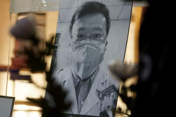 Associated Press photos A vigil was held Feb. 7, 2020, in Hong Kong to honor  Chinese physician  Li Wenliang,  the 35-year-old ophthalmologist who died from the coronavirus just weeks after being  reprimanded for warning about the new infection.