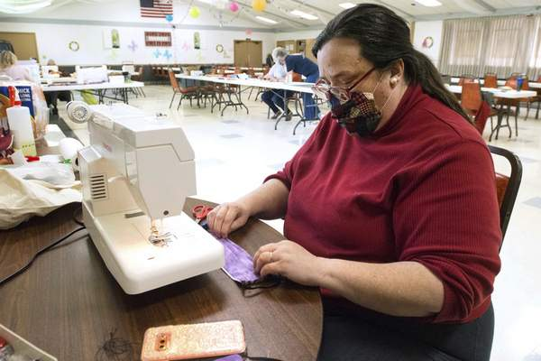 Michelle Davies | The Journal Gazette Betty Williams, of Fort Wayne, an auxiliary member of American Legion Post 47, works on sewing face masks that will be given to veterans and their families. To date 545 masks have been sewn by members of both the 4th District and Post 47 members and volunteers.