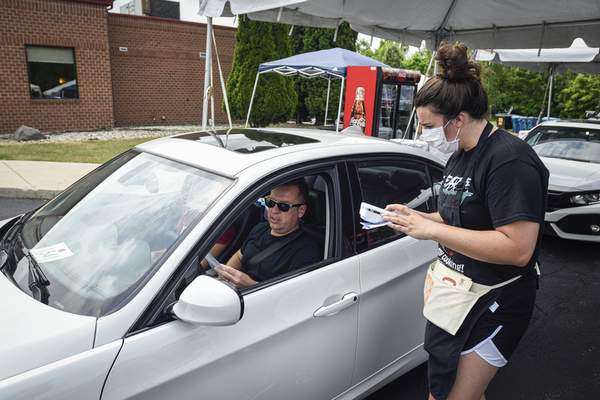 Mike Moore | The Journal Gazette Greek Fest was one of many summertime festivals that had to change last year because of the COVID-19 pandemic. It was a drive-thru event.
