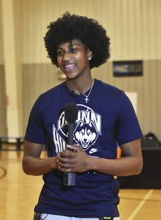 Katie Fyfe | The Journal Gazette  Homestead girls basketball player Ayanna Patterson announces that she will be going to UConn at McMillen Park Center on Saturday.