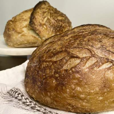 """Associated Press  Loaves of sourdough bread made by Broadway performer Max Kumangai are displayed in New York. The triple threat from the musical """"Jagged Little Pill� has leaned into a fourth skill as the pandemic marches on: baking and selling his own sourdough. (Michael Lowney/Humpday Dough via AP)"""