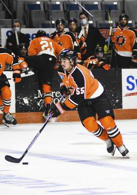 Katie Fyfe | The Journal Gazette  Komets forward Jackson Leef carries the puck during the second period against Indy Fuel at Memorial Coliseum on Friday.