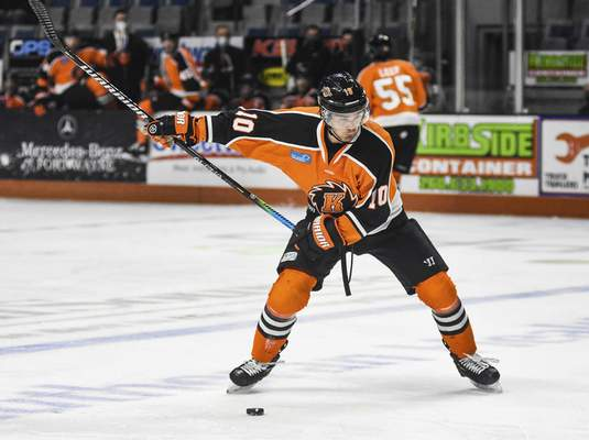 Katie Fyfe | The Journal Gazette  Komets defenseman Nick Boka hits the puck during the first period against Indy Fuel at Memorial Coliseum on Friday.
