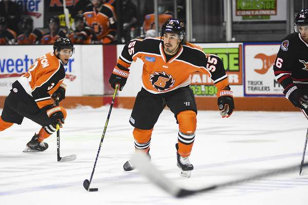 Katie Fyfe | The Journal Gazette Komets forward Jackson Leef carries the puck during the first period against Indy Fuel at Memorial Coliseum on Friday.