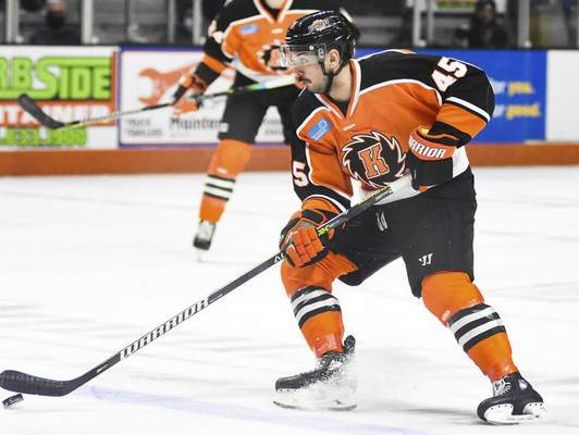 Katie Fyfe | The Journal Gazette  Komets' Zach Pochiro carries the puck during the second period against Indy Fuel at Memorial Coliseum on Friday.