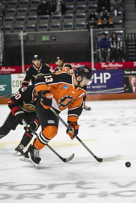 Katie Fyfe | The Journal Gazette  Komets forward Anthony Petruzzelli carries the puck during the first period against Indy Fuel at Memorial Coliseum on Friday.