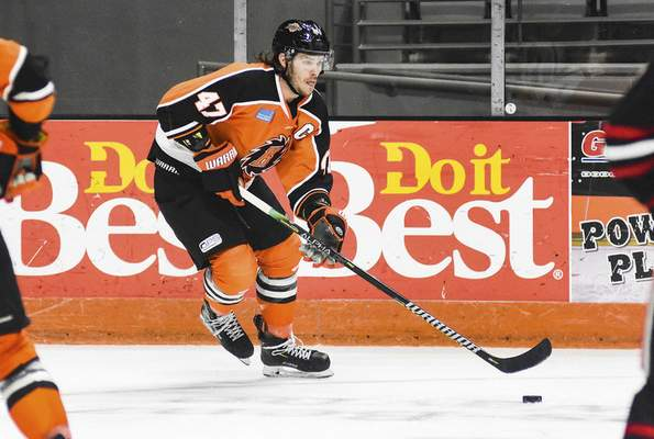 Katie Fyfe | The Journal Gazette  Komets forward A.J. Jenks carries the puck during the second period against Indy Fuel at Memorial Coliseum on Friday.
