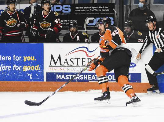 Katie Fyfe | The Journal Gazette  Komets' Zach Pochiro carries the puck during the first period against Indy Fuel at Memorial Coliseum on Friday.