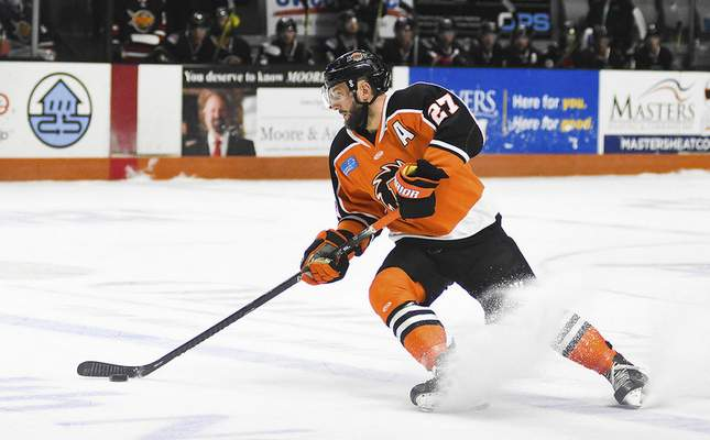 Katie Fyfe | The Journal Gazette  Komets forward Shawn Szydlowski carries the puck during the first period against Indy Fuel at Memorial Coliseum on Friday.