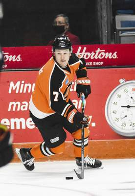 Katie Fyfe | The Journal Gazette  Komets forward Brandon Hawkins looks to make a pass during the second period against Indy Fuel at Memorial Coliseum on Friday.