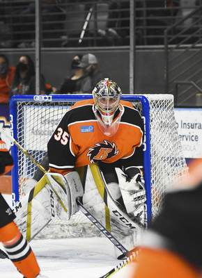 Katie Fyfe | The Journal Gazette  Komets goalie Dylan Ferguson keeps his eye on the puck during the first period against Indy Fuel at Memorial Coliseum on Friday.