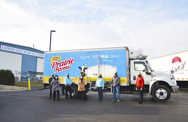 Katie Fyfe | The Journal Gazette  The Allen County Farm Bureau donates cheese to the Community Harvest Food Bank in celebration of National Ag Day on Tuesday morning.