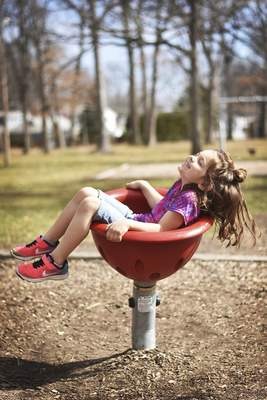 Katie Fyfe | The Journal Gazette  Nora, 5, plays at the Lions Park playground Monday afternoon.