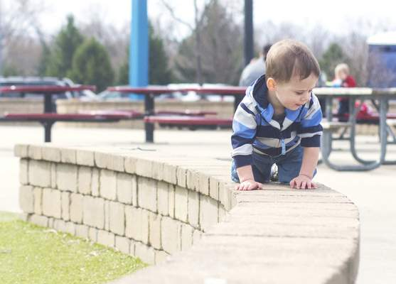 Michelle Davies | The Journal Gazette Isaiah Ebetino, 2, of Fort Wayne, takes in the view from above at Kreager Park Thursday morning.