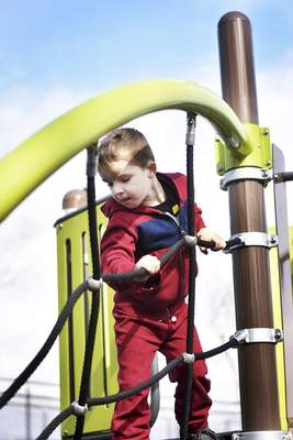 Katie Fyfe | The Journal Gazette  Chase Collette, 5, plays at the PNC Playground at Promenade Park Wednesday morning.