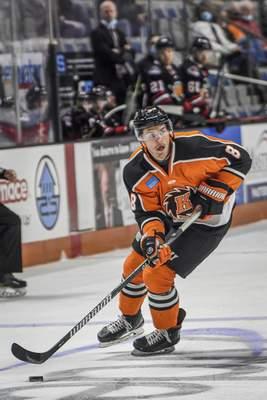 Mike Moore | The Journal Gazette Komets defenseman Blake Siebenaler looks to pass the puck in the first period against Indy at Memorial Coliseum on Saturday.