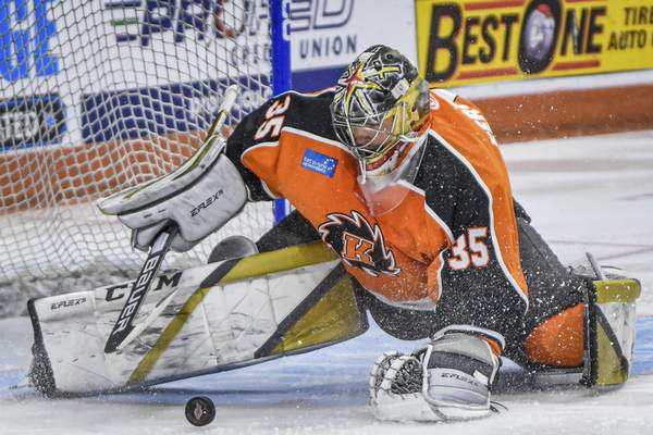 Mike Moore | The Journal Gazette  Komets goalie Dylan Ferguson stops a shot taken by Indy in the first period at Memorial Coliseum on Saturday.
