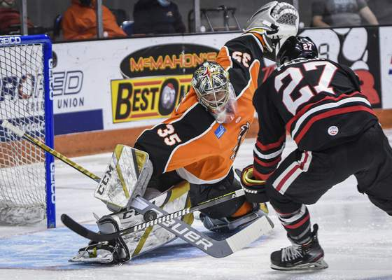 Mike Moore | The Journal Gazette  Komets goalie Dylan Ferguson stops a shot taken by Indy forward Michael Pelech in the first period at Memorial Coliseum on Saturday.