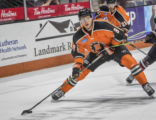 Mike Moore | The Journal Gazette Komets defenseman Blake Siebenaler eyes the net in the first period against Indy at Memorial Coliseum on Saturday.