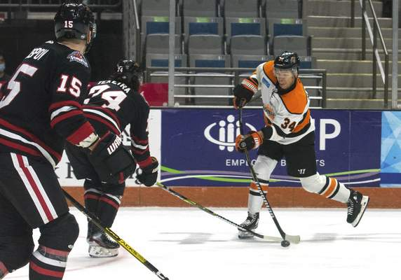Michelle Davies | The Journal Gazette  The Komets' Stephen Harper takes a shot on goal in the first period of Sunday's game against Indy Fuel at Memorial Coliseum.