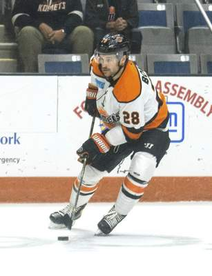 Michelle Davies | The Journal Gazette  The Komets' Matthew Boudens looks for a shot on goal in the second period of Sunday's game against Indy Fuel at Memorial Coliseum.