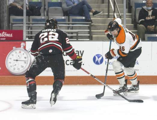 Michelle Davies | The Journal Gazette Kometsforward Justin Vaive works to get the puck around Indy's Jared Thomas in the second period of Sunday's game at Memorial Coliseum. Vaive scored one of the Komets' two goals Sunday.