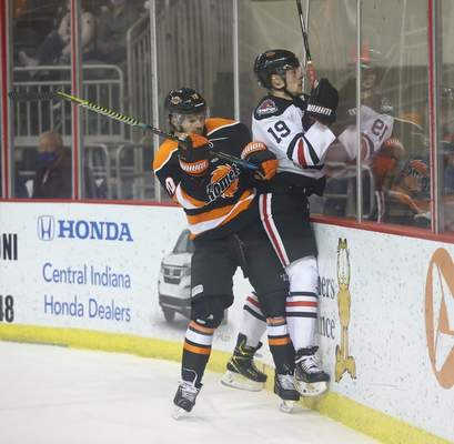 Whiteshark Photography  The Komets' Nick Boka, left, pins the Indy Fuel's Antoine Waked to the boards Wednesday night at Indianapolis.