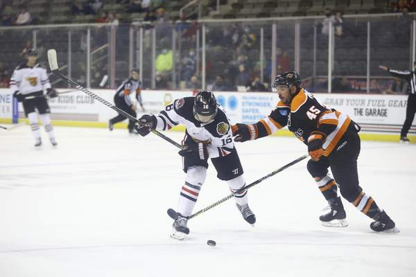 Whiteshark Photography  The Indy Fuel's Spencer Watson winds up to attempt a shot Wednesday night, as he's defended by the Komets' Zach Pochiro in Indianapolis.