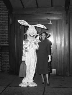 Mrs. Holman Hamilton welcomes the Easter Bunny upon his