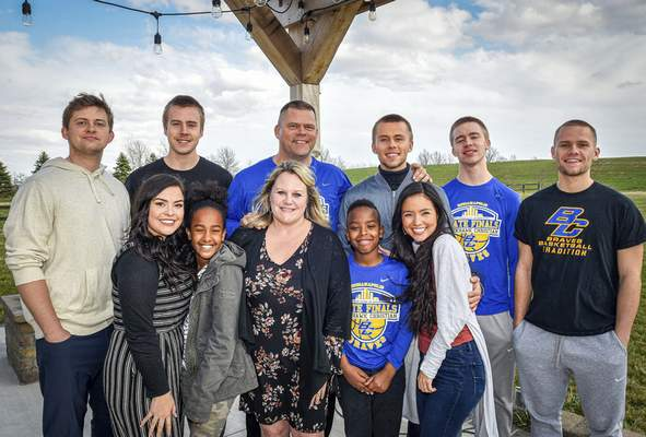 Mike Moore | The Journal Gazette Blackhawk Christian boys basketball coach Marc Davidson, rear center, poses with his family Wednesday.