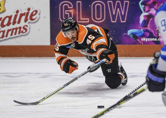 Mike Moore   The Journal Gazette Komets right wing Zach Pochiro dives for the puck in the first period against Jacksonville at Memorial Coliseum on Friday.