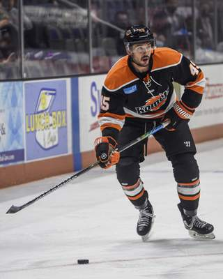 Mike Moore   The Journal Gazette Komets right wing Zach Pochiro looks to pass the puck in the first period against Jacksonville at Memorial Coliseum on Friday.