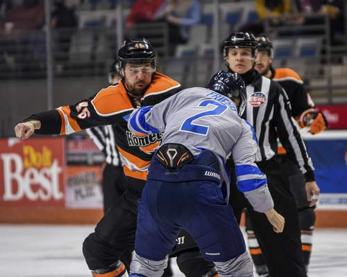 Mike Moore   The Journal Gazette Komets forward Justin Vaive and Jacksonville defenseman Jacob Friend throw punches in the first period at Memorial Coliseum on Friday.