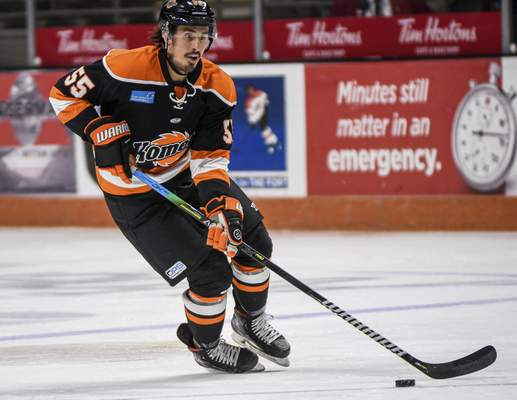Mike Moore   The Journal Gazette Komets forward Jackson Leef controls the puck in the first period against Jacksonville at Memorial Coliseum on Friday.