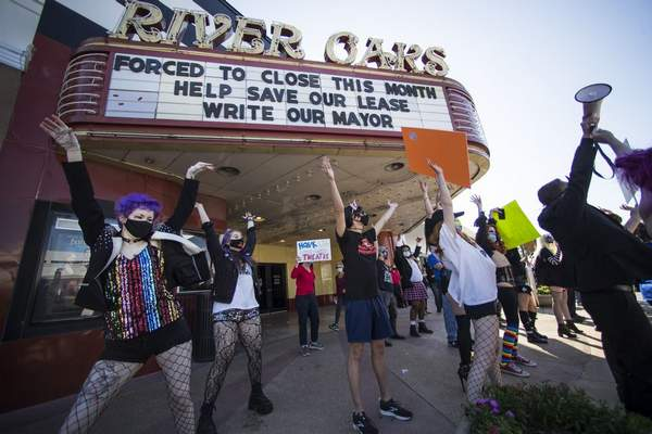 Fans and patrons of the Landmark River Oaks Theatre do the Time Warp, from the Rocky Horror Picture Show as they demonstrate against the potential closure of the historic movie theater Sunday, March 7, 2021, in Houston. ( Brett Coomer/Houston Chronicle via AP)