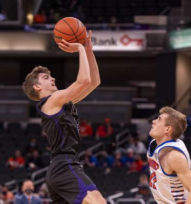 Leo High School senior Blake Davidson (12) puts up a shot during the second half of the 2021 IHSAA Class 3A Boys' Basketball State Championship game against Silver Creek High School, Saturday, April 3, 2021, at Bankers Life Fieldhouse in Indianapolis. (Doug McSchooler/for Journal-Gazette)