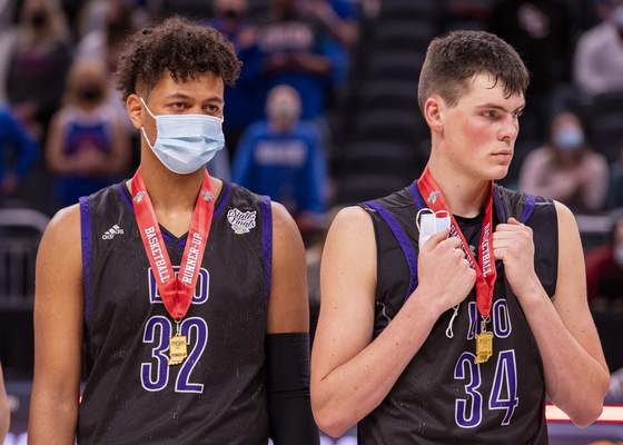 Leo High School players react to their loss after the 2021 IHSAA Class 3A Boys' Basketball State Championship game, Saturday, April 3, 2021, at Bankers Life Fieldhouse in Indianapolis. (Doug McSchooler/for Journal-Gazette)