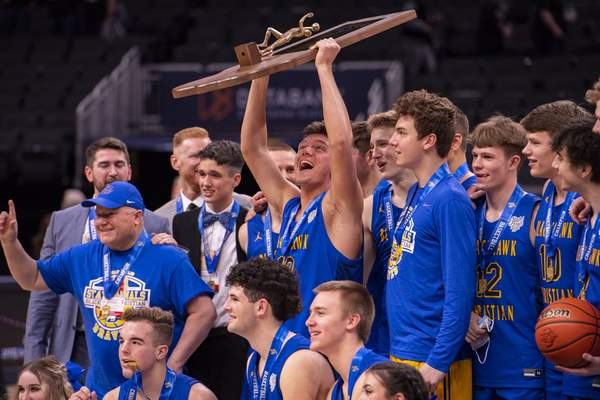 Fort Wayne Blackhawk Christian High School senior Andrew McIntosh (13) celebrates with the trophy after the 2021 IHSAA Class 2A Boys' Basketball State Championship game, Saturday, April 3, 2021, at Bankers Life Fieldhouse in Indianapolis. Fort Wayne Blackhawk Christian High School won 55-40. (Doug McSchooler/for Journal-Gazette)