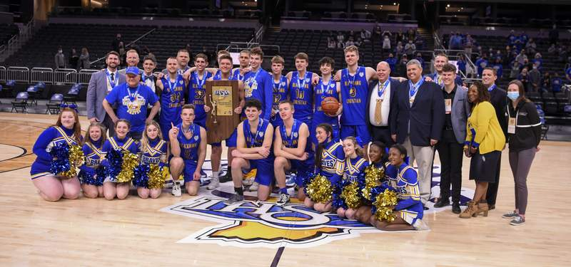 Fort Wayne Blackhawk Christian High School players celebrate with the trophy after the 2021 IHSAA Class 2A Boys' Basketball State Championship game, Saturday, April 3, 2021, at Bankers Life Fieldhouse in Indianapolis. Fort Wayne Blackhawk Christian High School won 55-40. (Doug McSchooler/for Journal-Gazette)