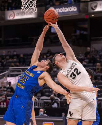 Fort Wayne Blackhawk Christian High School junior Jacob Boyer (32) and Parke Heritage High School senior Connor Davis (32) battle for the ball during the first half of the 2021 IHSAA Class 2A Boys' Basketball State Championship game, Saturday, April 3, 2021, at Bankers Life Fieldhouse in Indianapolis. (Doug McSchooler/for Journal-Gazette)