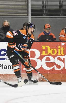 Katie Fyfe | The Journal Gazette  Komets forward Jackson Leef makes a pass during the second period against Wheeling Nailers at Memorial Coliseum on Saturday.