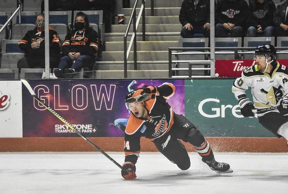Katie Fyfe | The Journal Gazette  Komets forward Randy Gazzola falls chasing the puck during the first period against Wheeling Nailers at Memorial Coliseum on Saturday.