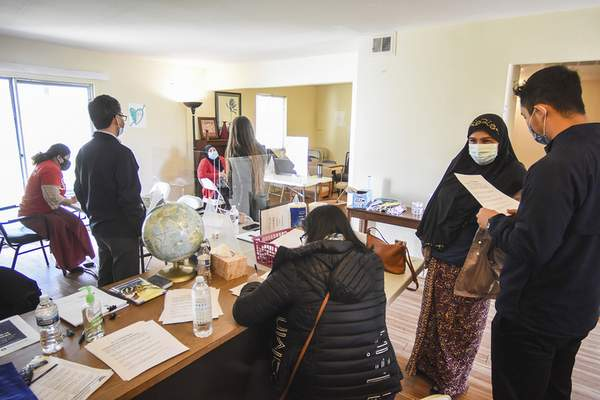 Katie Fyfe | The Journal Gazette  Catholic Charities hold the first of three events aimed at registering former refugees for COVID vaccines on Wednesday, March 31st, 2021.