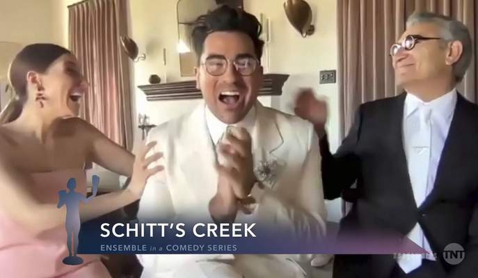 In this video grab provided by the SAG Awards, Sarah Levy, from left, Daniel Levy and Eugene Levy accept the award for outstanding performance by an ensemble in a comedy series for Schitt's Creek during the 27th annual Screen Actors Guild Awards on April 4, 2021. (SAG Awards via AP)