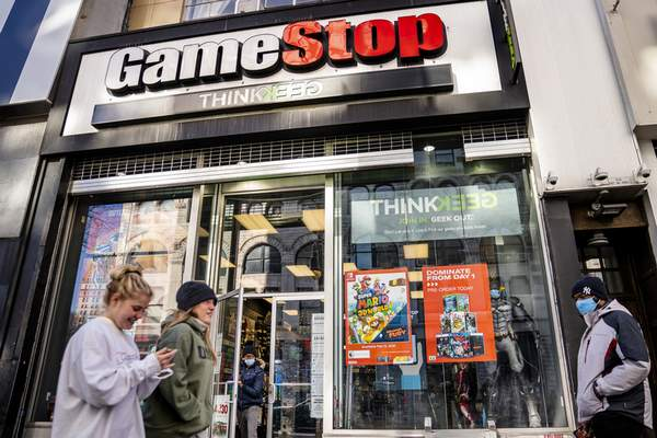 FILE - In this Jan. 28, 2021, file photo, pedestrians pass a GameStop store on 14th Street at Union Square, in the Manhattan borough of New York. (AP Photo/John Minchillo, File)