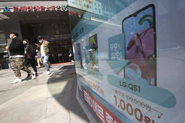 An image of LG Electronics Inc.'s smartphone Q51 is seen at a mobile phone shop in Seoul, South Korea, Monday, April 5, 2021. (AP Photo/Ahn Young-joon)