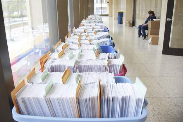 FILEAbout 20,000 mail-in ballots at the Allen County Election Board office.