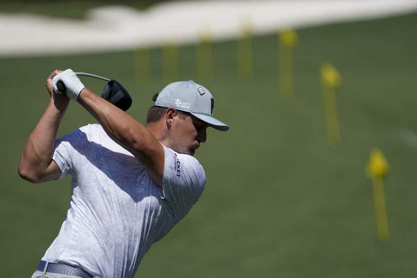 Associated Press Bryson DeChambeau warms up on the range before a practice round for the Masters on Monday in Augusta, Ga.