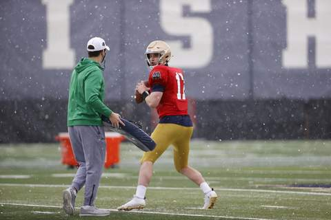 Notre Dame Athletics Notre Dame fifth-year senior quarterback Jack Coan works with offensive coordinator Tommy Rees during spring practice.